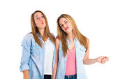 Friends doing a joke over isolated white background — ストック写真