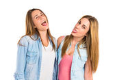 Friends doing a joke over isolated white background — Stockfoto