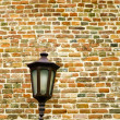 Brick wall with old metal lamp — Stockfoto