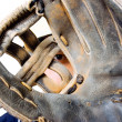 Young baseball player and his glove — Stock Photo