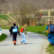 Royalty-Free Stock Photo: Two boys and two girls going to school