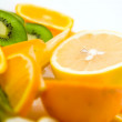 Kiwi and oranges — Stock Photo