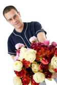 Young baseball player with bunch of fake roses — Stock Photo