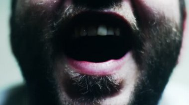 SUPER 35MM CAMERA - Freaky bearded man opening his mouth in slow motion — Stock Video