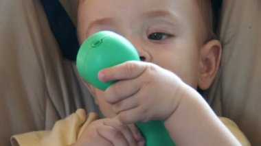 Cute baby playing with a green plastic phone — Stock Video