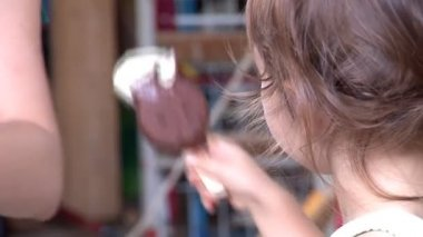 Cute blue-eyed girl licking an ice-cream — Stock Video