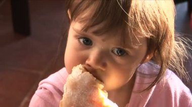 Little girl eating bread — Stock Video