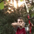 Stock Video: Young mshooting with bow and arrows