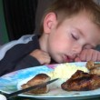 Stock Video: Kid sleeping at lunch table