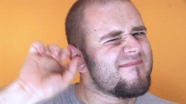 Man picking his ear and enjoying it — Stock Video