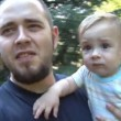 Father carrying his son and walking — Stock Video #26326943