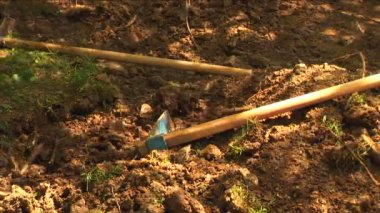 Digging tools laying on the ground — Stockvideo