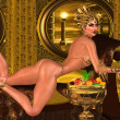 Woman in thong on chaise lounge with gold crown and multiple suns in the sci fi background. — Stock Photo