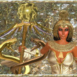 Close up of Imperial Goddess, holding a scepter with two gold snakes. — Stock Photo
