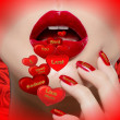 Woman's mouth with red hearts and love messages written on them. — Stock Photo