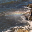 Rainbow colors the water spray — Stock Photo