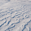 Stock Photo: Background of white sparkling snowdrift looking like dune