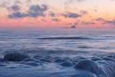 Before sunrise on icy beach. Feodosia, Crimea — Zdjęcie stockowe