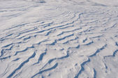 Background of white sparkling snowdrift looking like dune — Stock Photo