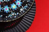 Two open hand fan on the red background — Stock Photo