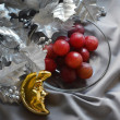 Silvery Christmas tree branch, grapes and yellow crescent — Stock Photo
