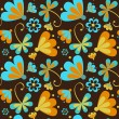 Pattern orange and blue flowers on a brown background — Stock Vector