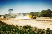 Truck in dusty road — Stock Photo