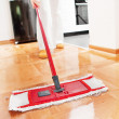 House cleaning -Mopping hardwood floor — Стоковая фотография