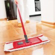 House cleaning -Mopping hardwood floor — Stock fotografie
