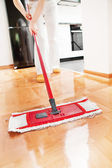 House cleaning -Mopping hardwood floor — Stock Photo