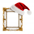 Santa Claus hat hung on the vintage frame — Stock Photo #44891349