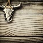 Buffalo skull on wooden background — Stockfoto