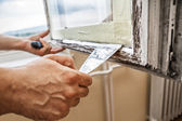 Repairing a window frame — Stock Photo