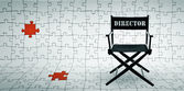 Director chair on jigsaw puzzle background — Stock Photo