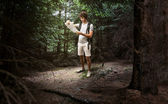 Man hiker hiking in forest — Stock Photo