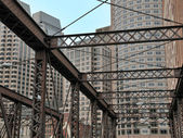 Old bridge and new buildings — Stock Photo