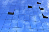 Modern glass wall with reflections — Stock Photo