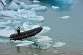 A man on rubber boat on Jokulsarlon Glacier Lake, Iceland — Stok fotoğraf