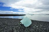 Little iceberg on the sand beach — Stock Photo