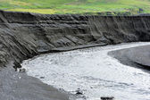 Canyon in black volcanic sand — Stock Photo