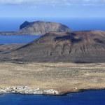 Постер, плакат: View of Graciosa Island mount Mojon from Mirador del Rio Lanz