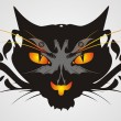 Tribal cat head on a gray background — Stock Vector