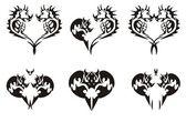 Black tribal dragons hearts — Vector de stock