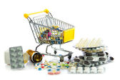 Shopping trolley with pills isolated on white background — Foto Stock