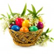 Easter eggs in busket on green gras isolated concept holyday — Stock Photo #41204191