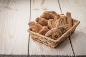 Cookies in wickerwork hamper — Stock Photo