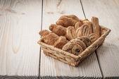 Cookies in wickerwork hamper — Stock Photo