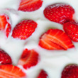 Strawberries in yogurt close up — Stock Photo