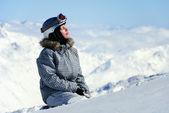 Female skier enjoying sun — Stock Photo