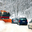 Snow plow cleaning the road - Stock Photo
